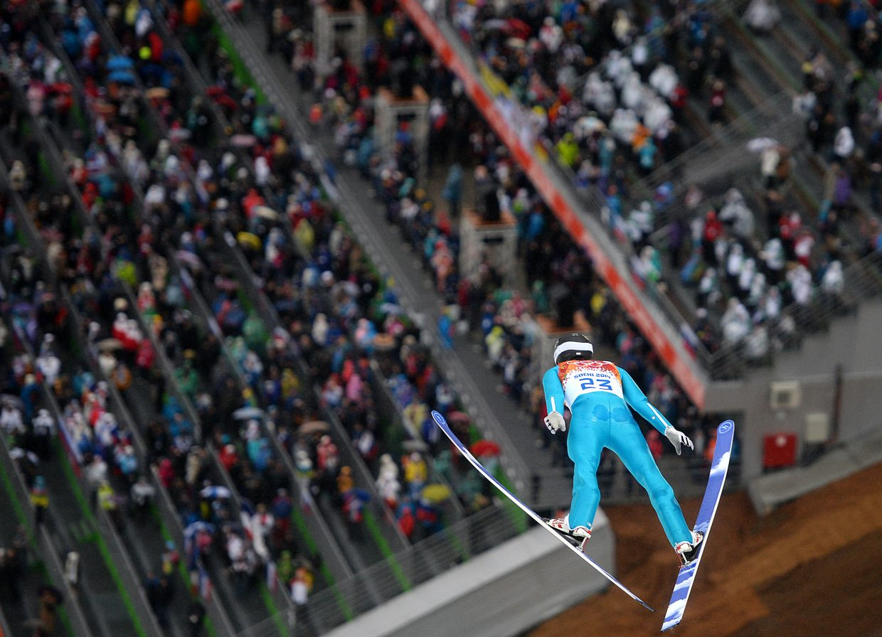 Taylor Fletcher flies over the crowd Tuesday at the large hill Nordic combined competition at the 2014 Winter Olympics.