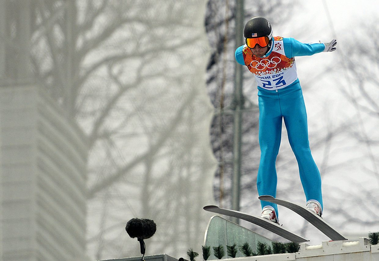 Taylor Fletcher leaps from the jump Tuesday at the Nordic combined large hill event at the 2014 Winter Olympics.