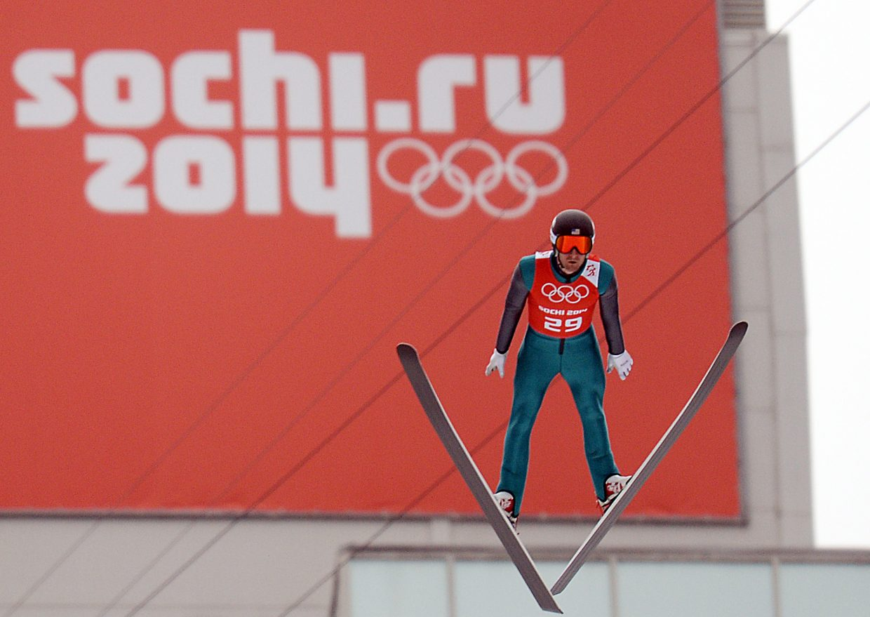 Taylor Fletcher flies high from the large hill ski jump Monday during Nordic combined training at the RusSki Gorki Jumping Center in Krasnaya Polyana, Russia. The second Nordic combined competition is set for Tuesday.