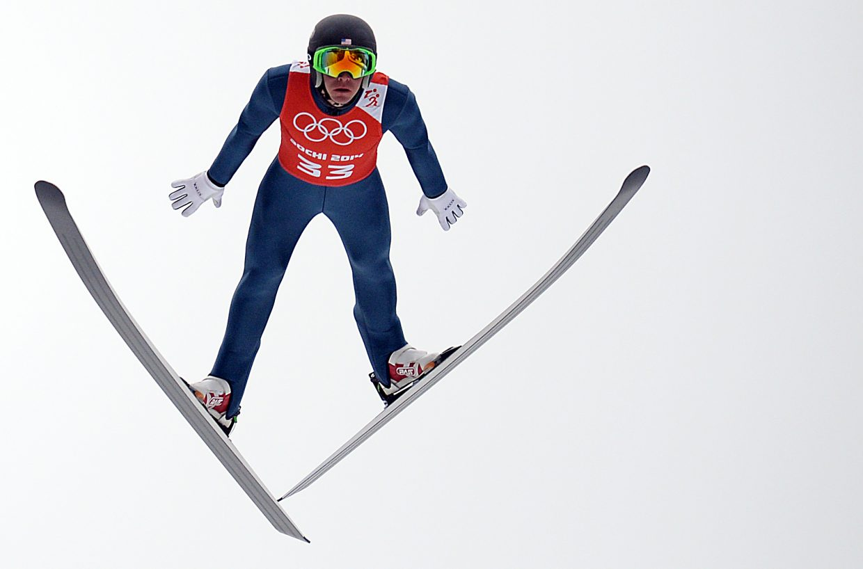 Billy Demong soars Monday in Nordic combined training at the 2014 Winter Olympics.