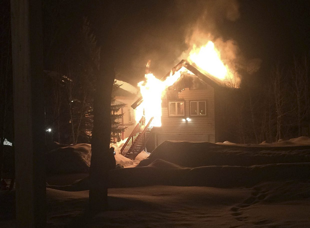 Fire engulfs half of a duplex Tuesday night on Cherry Drive in Steamboat Springs.