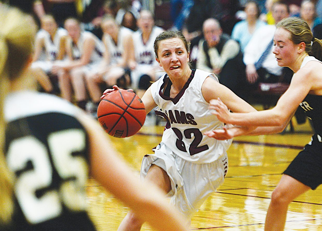 Soroco senior Morgan George drives toward the basket in the first half of Friday's game against Meeker. The Cowboys took a 34-30 lead in the first half, but the Rams pulled it out in the end, securing a second-place finish in league play.