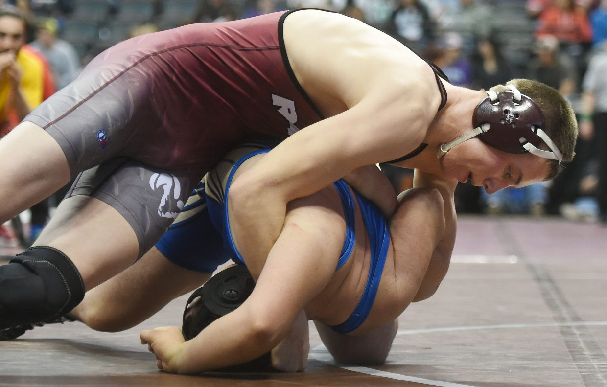 Soroco's Sky Carlson pushes his opponent for the pin Thursday at the state wrestling tournament in Denver.