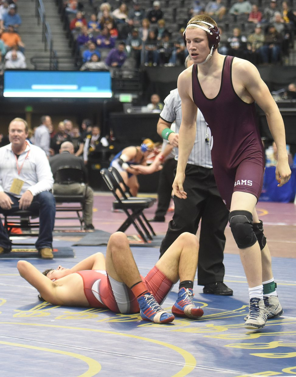Soroco's Sky Carlson walks away after a quarterfinal pin on Friday at the state wrestling championships in Denver.