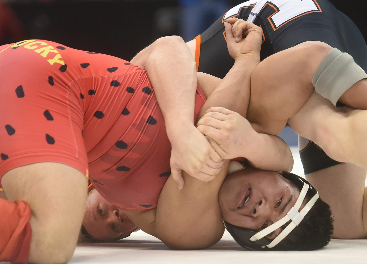 Hayden's Christian Carson, left, wrestles against Ricky Preciado of Rocky Ford on Friday at the state wrestling tournament in Denver.