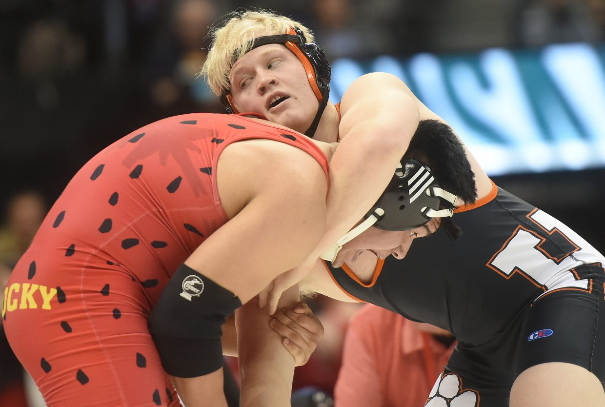 Hayden's Christian Carson wrestles against Ricky Preciado of Rocky Ford on Friday at the state wrestling tournament in Denver.