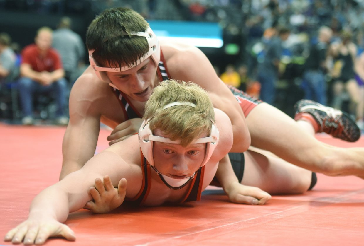 Steamboat's Hayden Johnson, bottom, wrestles Eaton's Braeson Lewis on Friday at the state championships in Denver.