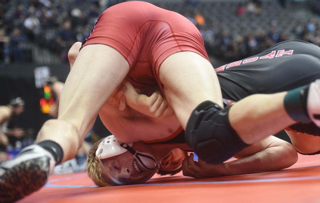 Steamboat's Hayden Johnson wrestles Eaton's Braeson Lewis on Friday at the state championships in Denver.