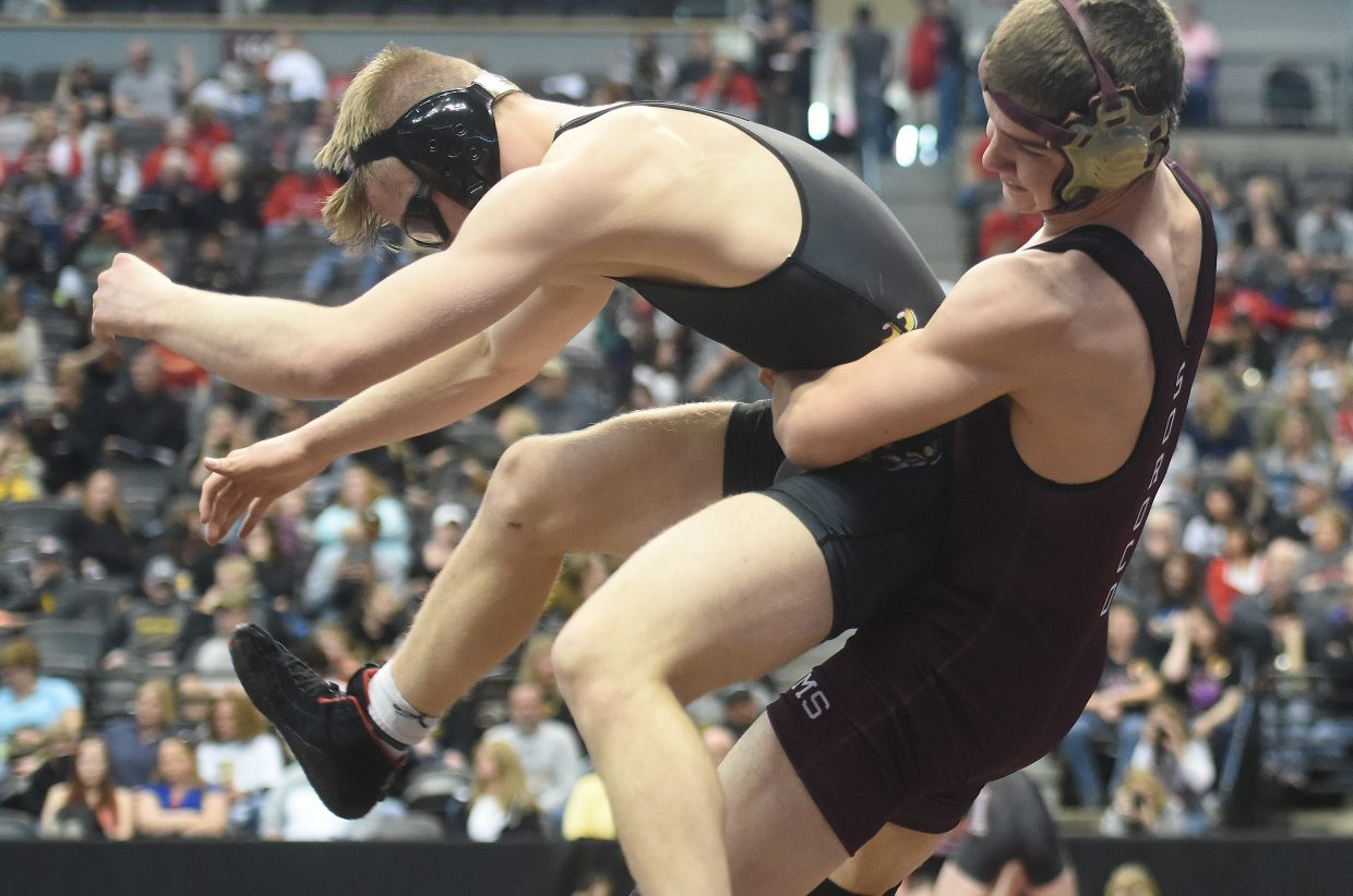Soroco's Lane Martindale throws his opponent, Peyton's Britton Holmes, Friday at the state championships in Denver.