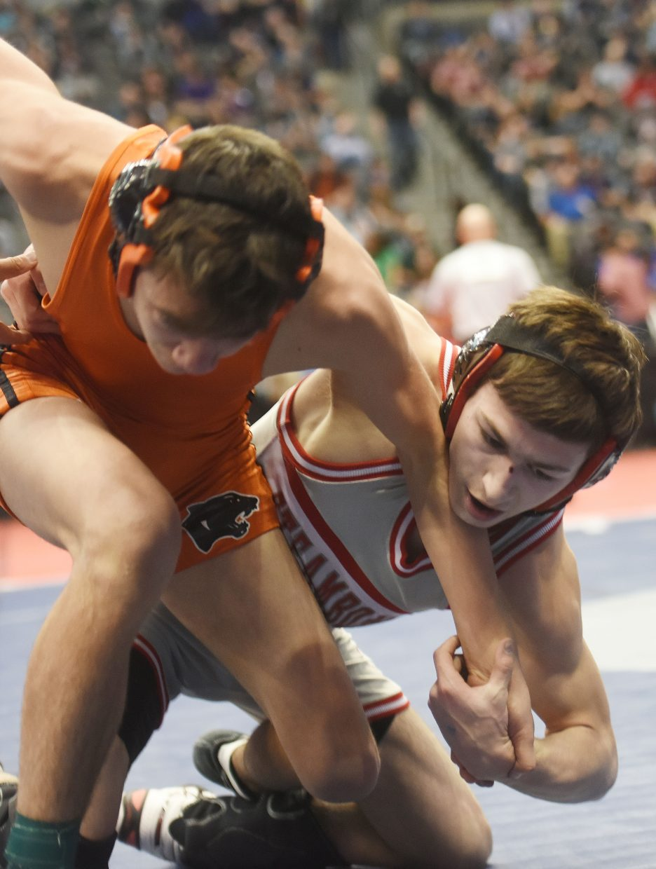Colton Pasternak wrestles Friday at the state championship in Denver.