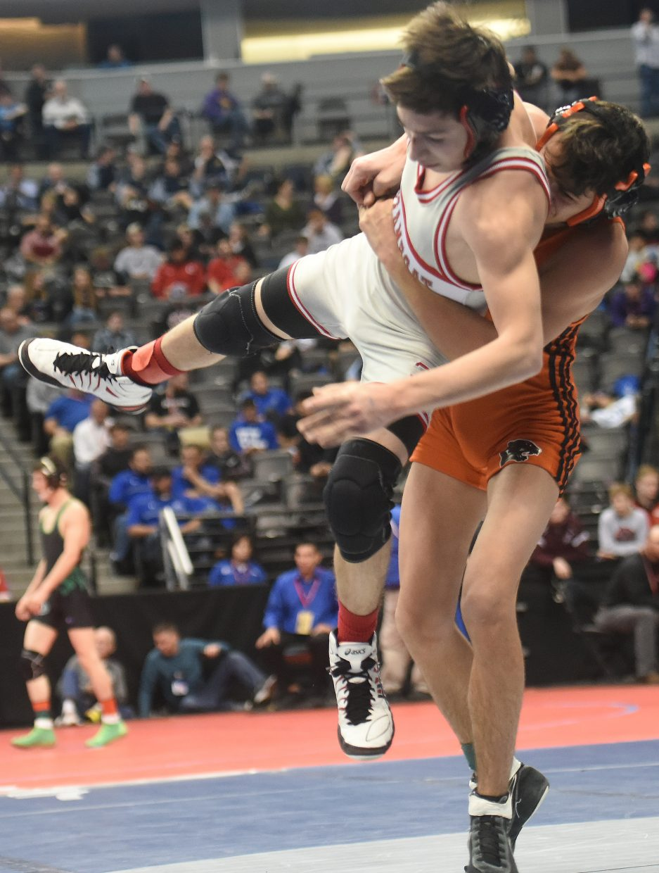 Colton Pasternak gets taken for a ride on Friday during a consolation match at the state championship in Denver. He went on to win the match, but lost in the next round and fell short of a medal.