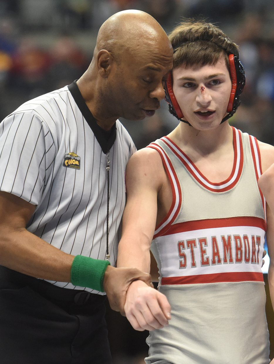 Colton Pasternak waits to be declared the winner on his first consolation match Friday at the state championship in Denver.