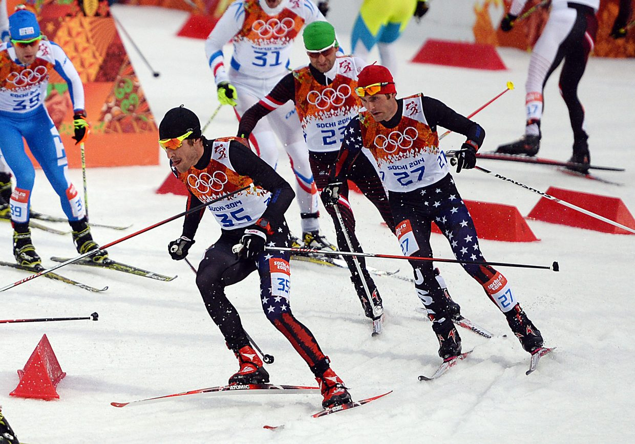Taylor Fletcher, right, and Bryan Fletcher lead a pack of skiers Tuesday during the Nordic combined large hill event at the 2014 Winter Olympics. The Steamboat Springs brothers finished 20th and 22nd in the event.