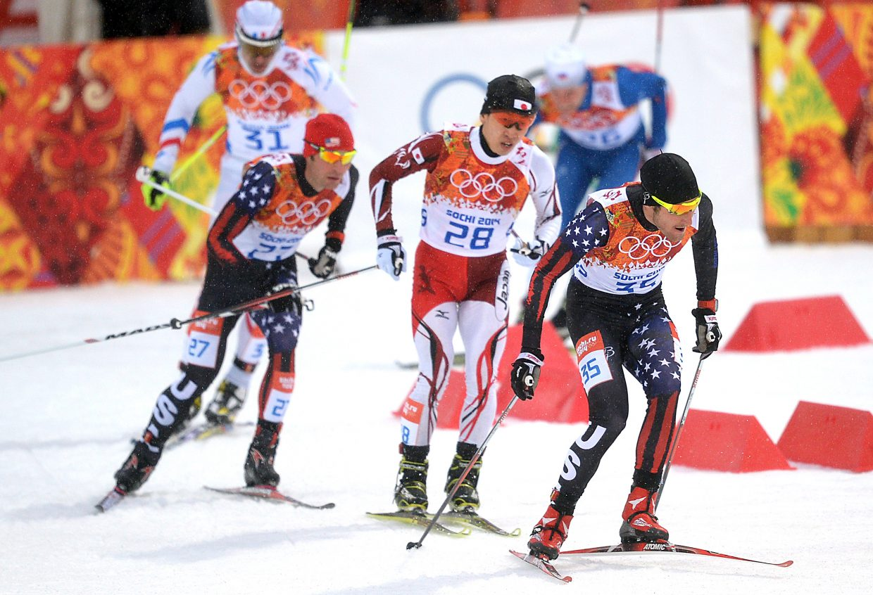 Taylor Fletcher leads a pack Tuesday during the large hill Nordic combined event at the 2014 Winter Olympics.