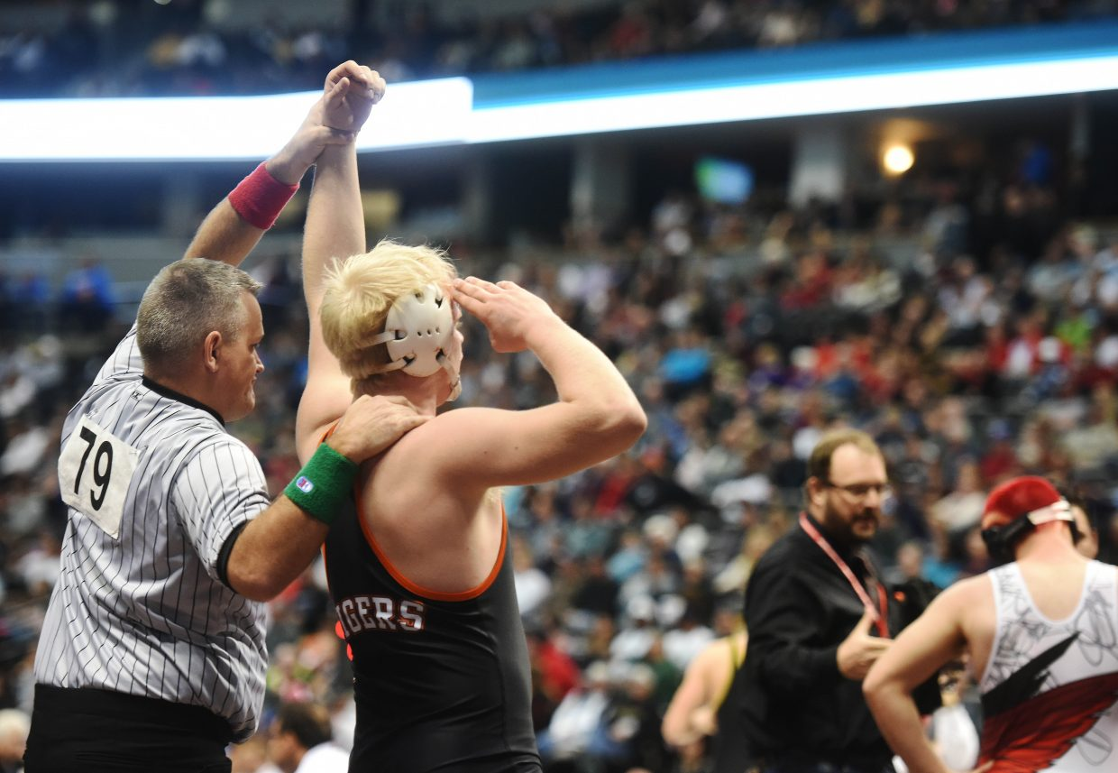 Hayden senior Christian Carson salutes the crowd Friday after winning his semifinal match at the state wrestling tournament in Denver.