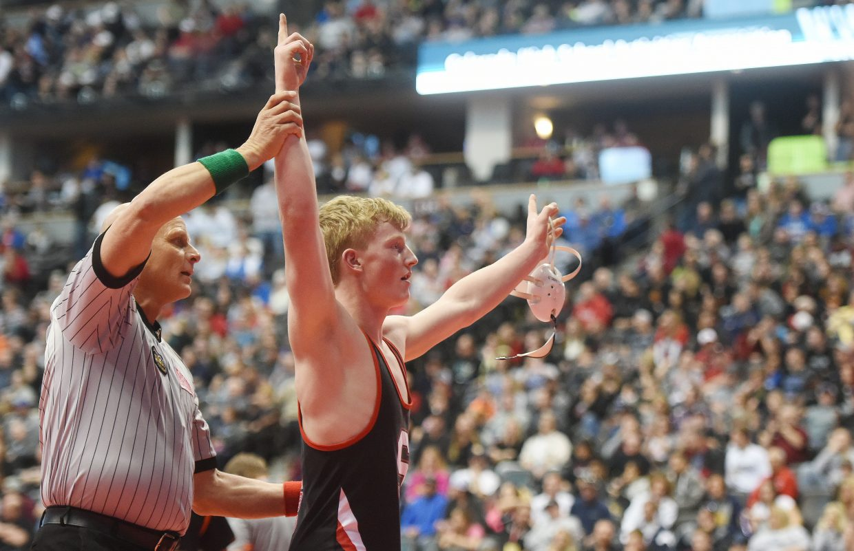 Steamboat Springs junior Hayden Johnson celebrates after winning his semifinal match Friday at the state wrestling tournament in Denver.
