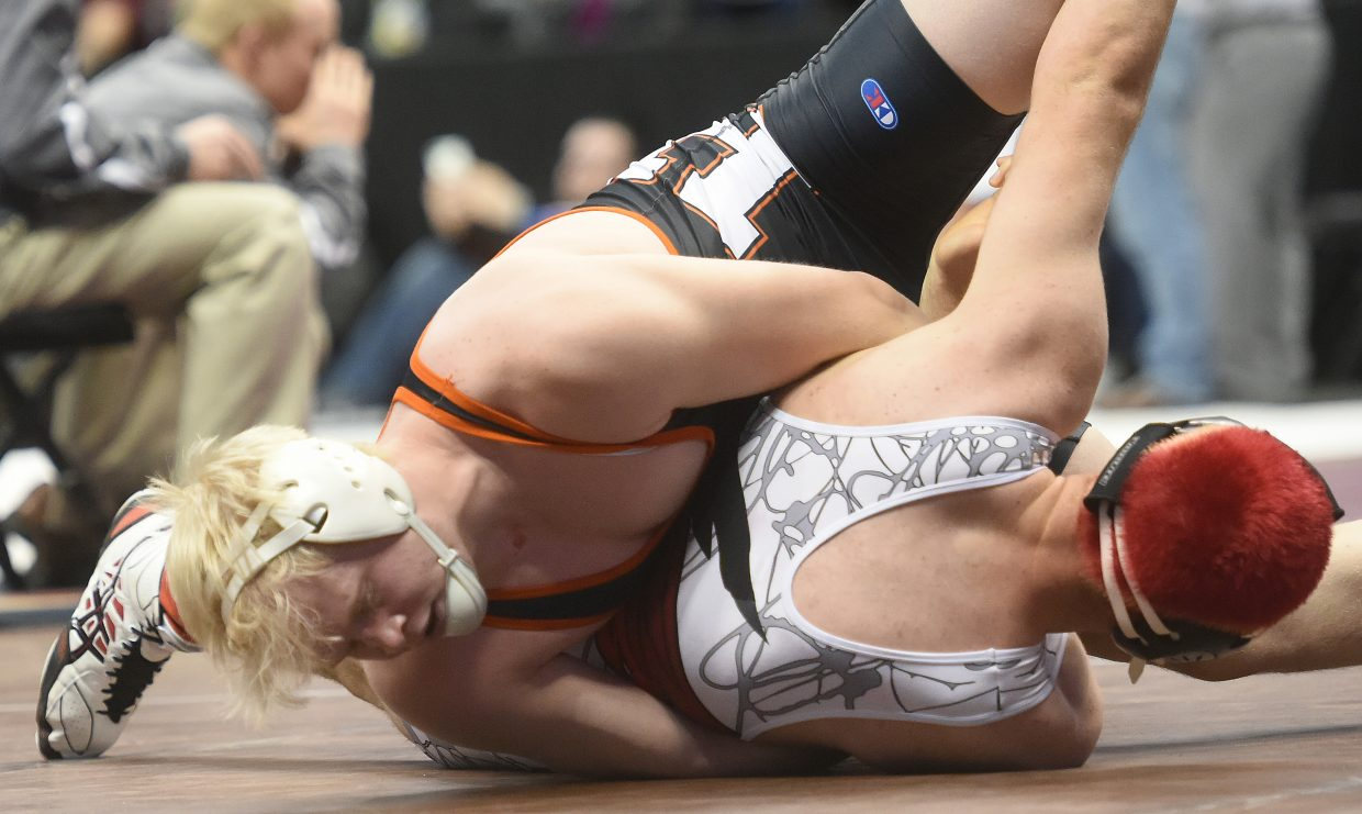 Hayden's Christian Carson wrestles Friday in the semifinals at the state tournament in Denver.