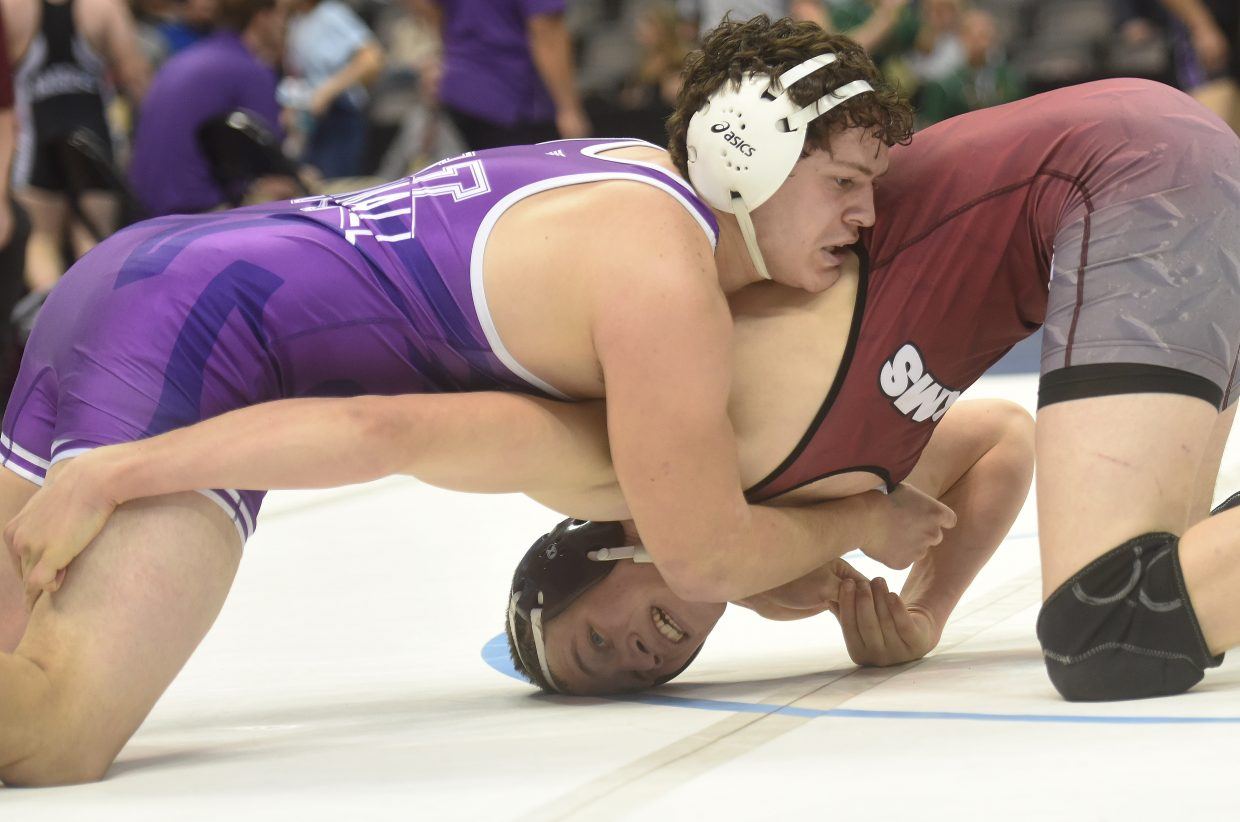 Soroco's Sky Carlson reaches for a move Friday at the state wrestling tournament in Denver.