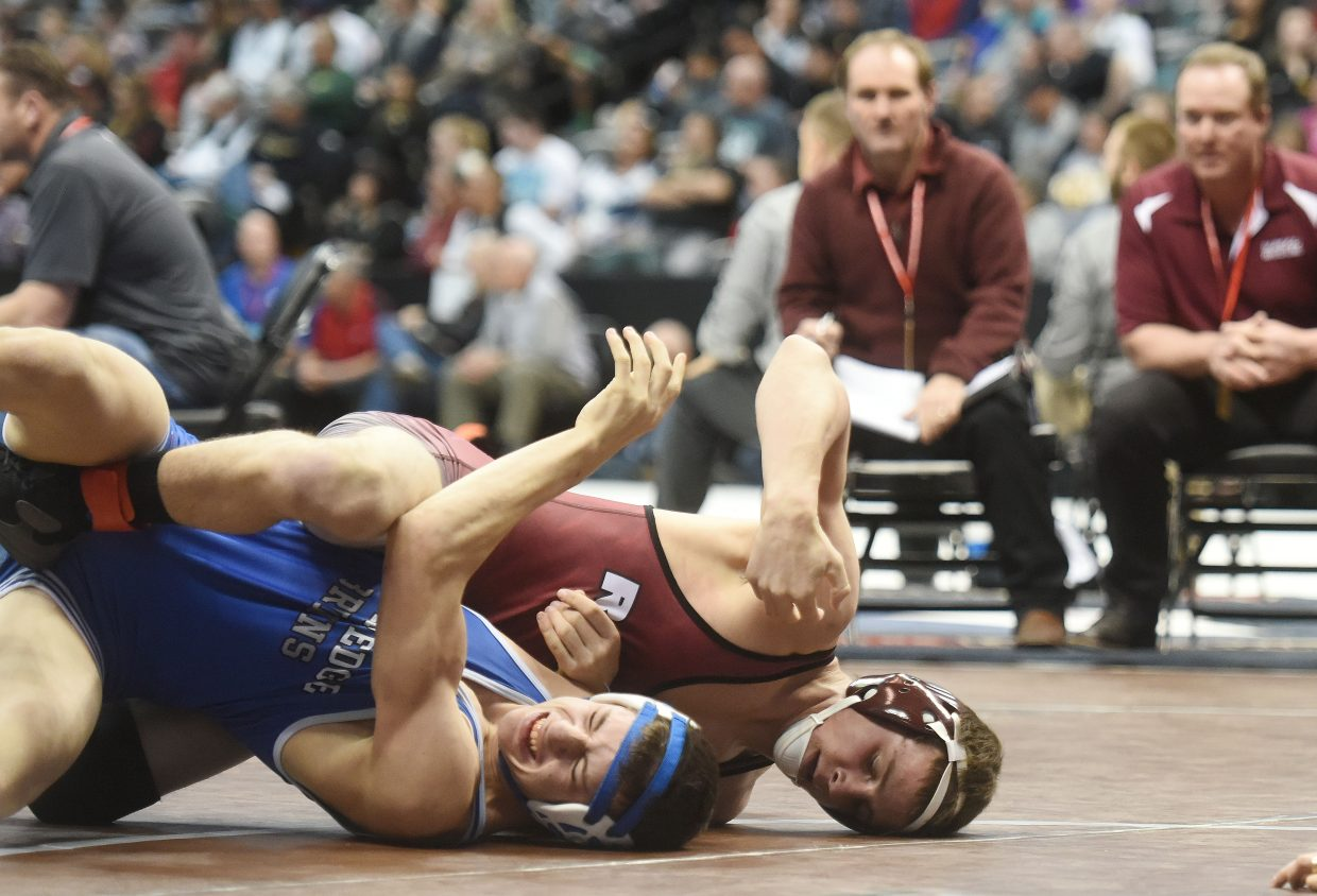 Soroco's Jace Logan wrestles for the semifinals on Friday at the state wrestling tournament in Denver. (Photo by Joel Reichenberger)