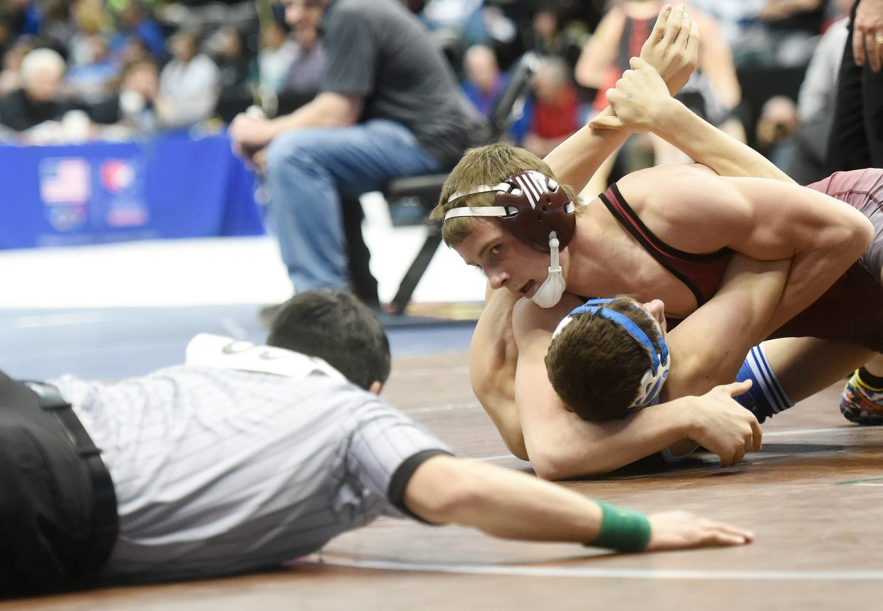 Soroco's Jace Logan wrestles for the semfinals on Friday at the state wrestling tournament in Denver.