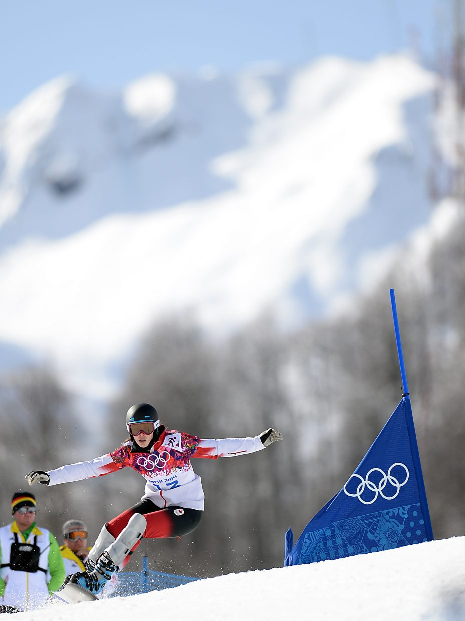 Caroline Calve, who trained with the Steamboat Springs Winter Sports Club, rides Wednesday in the women's snowboard parallel giant slalom event at the 2014 Winter Olympics.