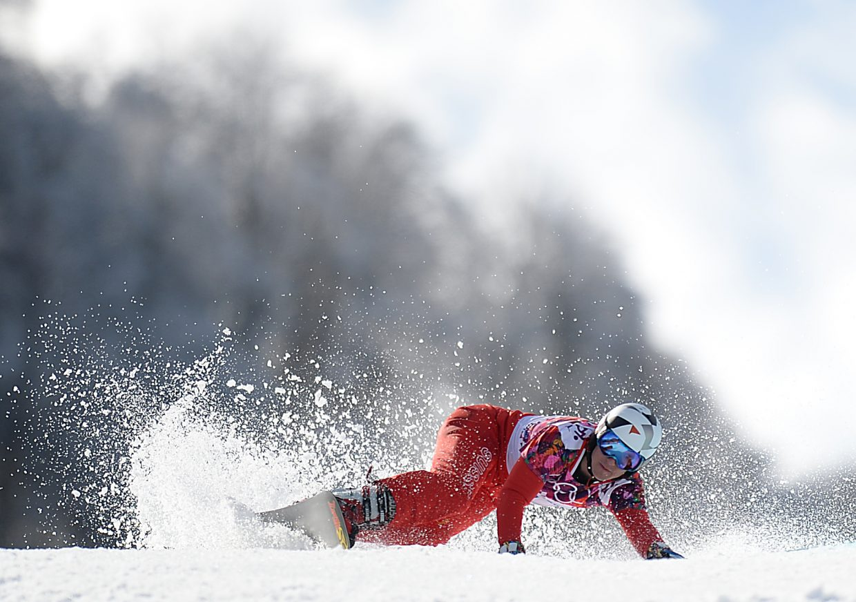 Swiss snowboarder Nevin Galmarini cuts hard around a corner Wednesday during the men's parallel giant slalom event at the 2014 Winter Olympics. Galmarini won silver in the event.