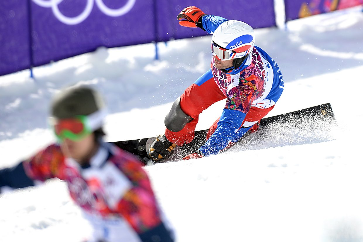 France's Sulvain Dufour tries to keep up with Vic Wild on Wednesday during the men's parallel giant slalom event at the 2014 Winter Olympics. He couldn't Wild won gold.