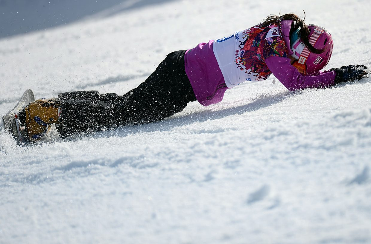 Japan's Tomoka Takeuchi buries her face after crashing in the women's final at parallel giant slalom on Wednesday. She won silver.