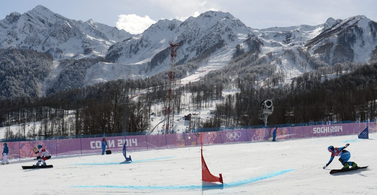 A pair of racers tear down the parallel giant slalom course Wednesday at the 2014 Winter Olympics.