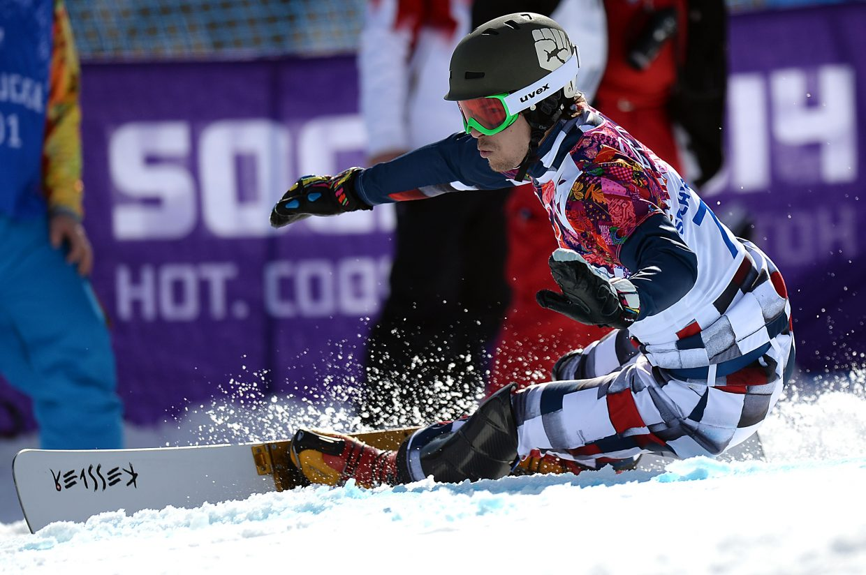Vic Wild cuts down the hill during the parallel giant slalom event at the 2014 Winter Olympics. He went on to win the gold medal, one of two he won at that Olympics.