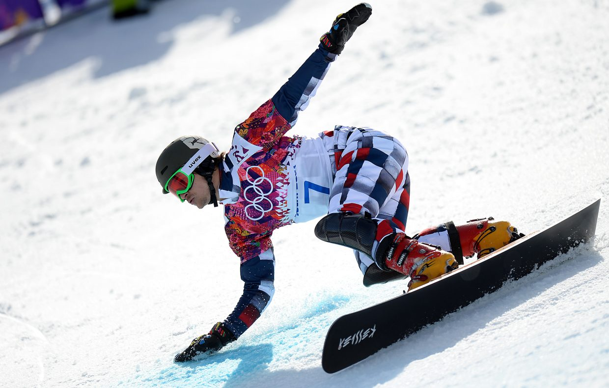 Vic Wild rides en route to a gold medal Wednesday in the parallel giant slalom event at the 2014 Winter Olympics.