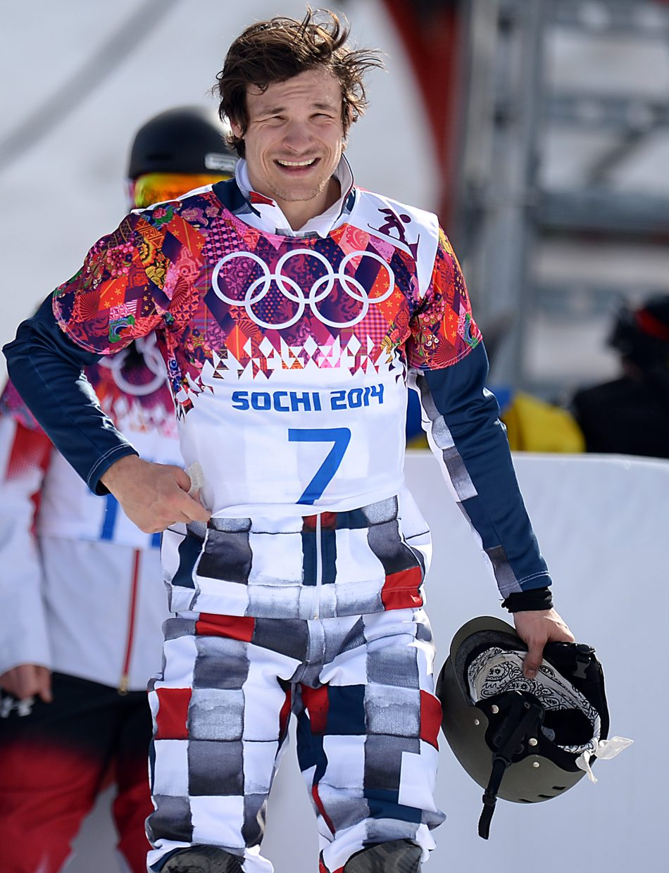 Vic Wild looks up the mountain moments after winning gold in the men's parallel giant slalom.
