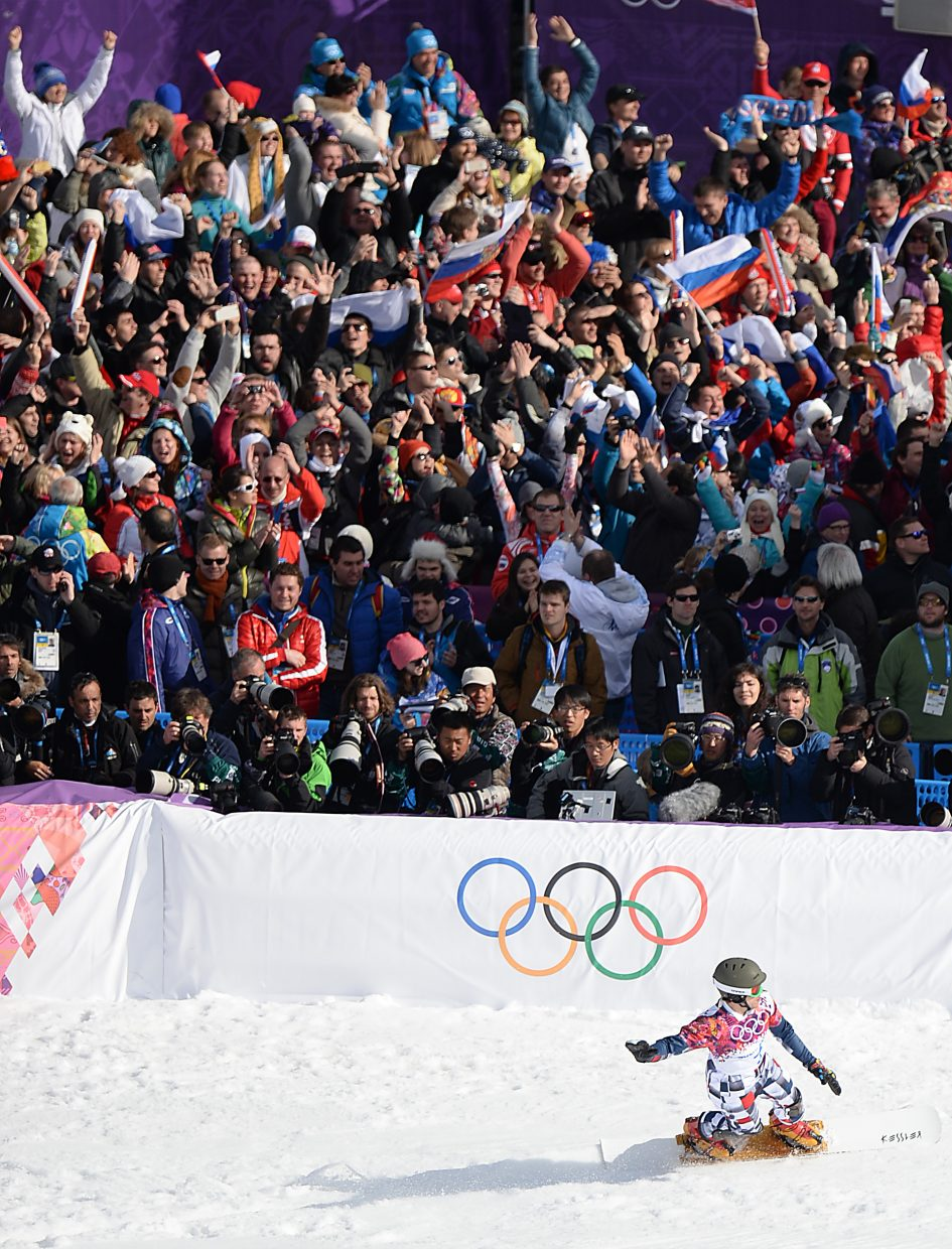 Vic Wild slides into the finish line Wednesday after winning the gold medal in the men's parallel slalom event at the 2014 Winter Olympics.