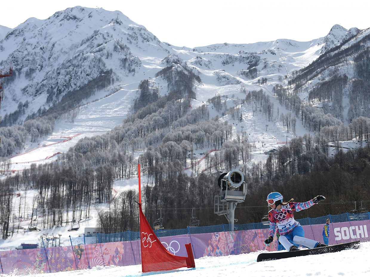Alena Zavarzina, a Russian snowboarder married to former Steamboat Springs athlete Vic Wild, rips down the course in the parallel giant slalom event at the 2014 Winter Olympics. Zavarzina won bronze for the women while Wild won gold on the men's side.
