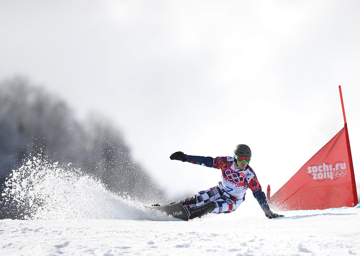 Vic Wild flies around a gate on what turned out to be his gold-medal run in the men's parallel giant slalom at the Rosa Khutor Extreme Park in Krasnaya Polyana, Russia, site of the 2014 Winter Olympics mountain events. Wild was born in the United States and trained in Steamboat Springs but received Russian citizenship in 2012 after American funding for his sport dried up.