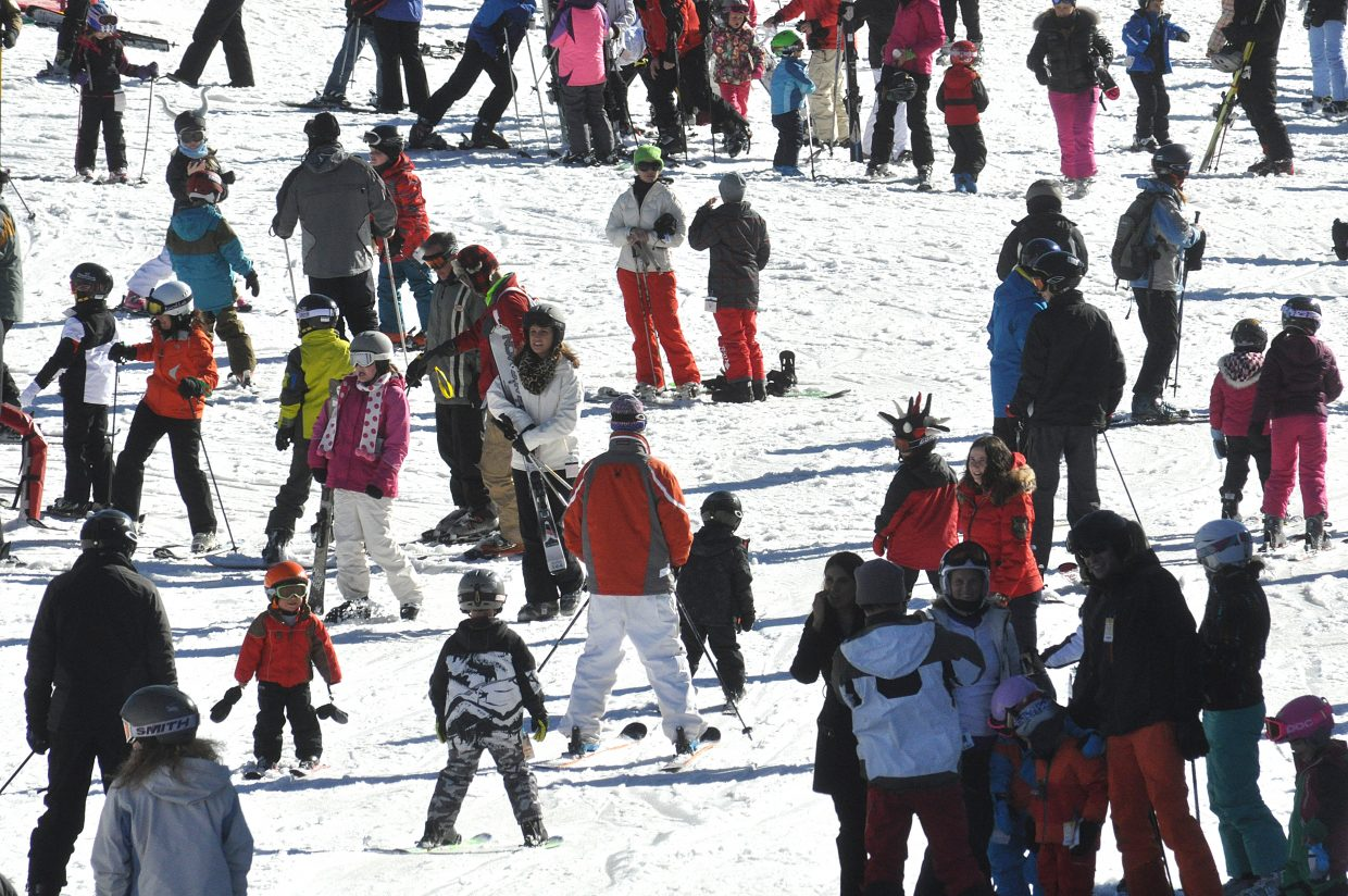 Skiers congregate at the base of the Steamboat Ski Area on Wednesday afternoon. Sales tax collections in the mountain area were up 17 percent in December compared to the same month in 2013.