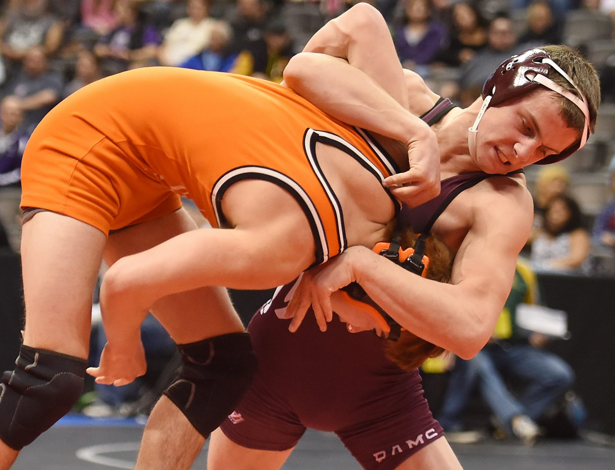 Soroco freshman Jace Logan works his opponent, Israel Baeza from Cheyenne Wells, before eventually registering a pin. Logan was one of five wrestlers from Routt County high schools to advance on the tournament's first day.