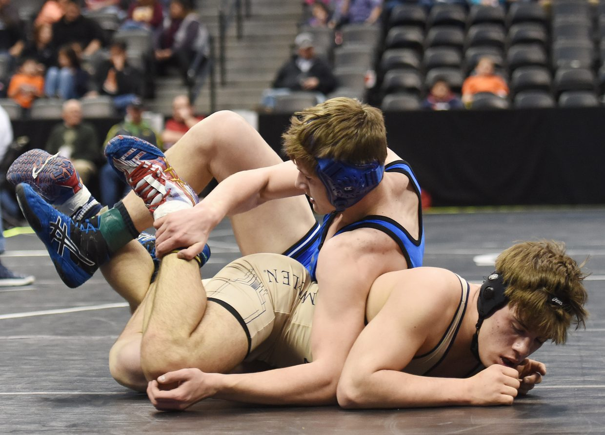Moffat County's Mikinzie Kilmper puts the pressure on Ian Vigil of Mullen on Thursday during the opening round of the Class 3A state wrestling tournament in Denver. Kilmper won the match decisively, racking up a 16-point lead to register a tech fall.