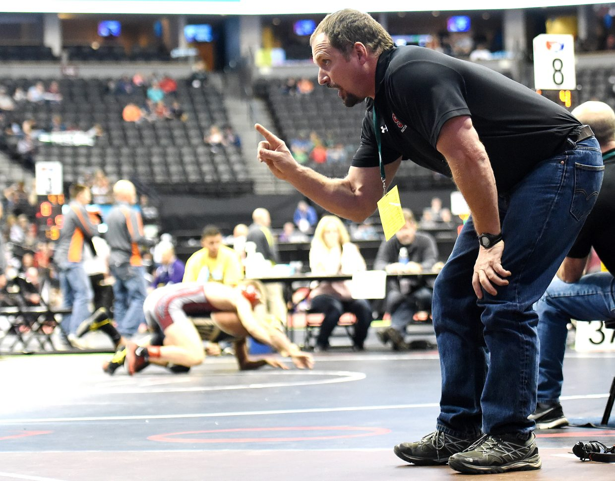 Steamboat Springs High School wrestling coach Travis Bryant passes along instruction Thursday at the state wrestling tournament in Denver.