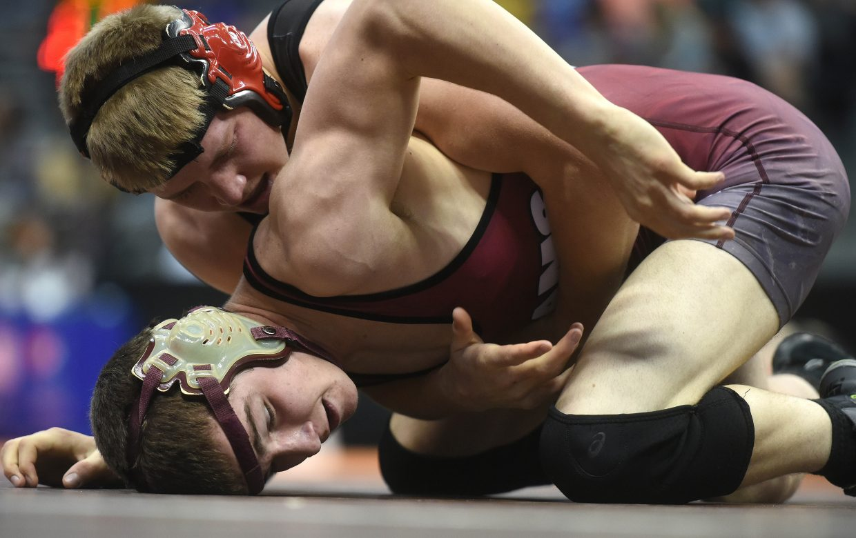 Soroco's Lane Martindale, bottom, wrestles in the consolation bracket Saturday at the state tournament in Denver. Martindale placed sixth in the tournament.