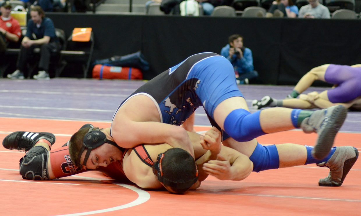 Stelios Peroulis tries to complete a takedown Thursday in the first round of the 3A state wrestling tournament. Peroulis held a 6-4 lead but was pinned in the second period.