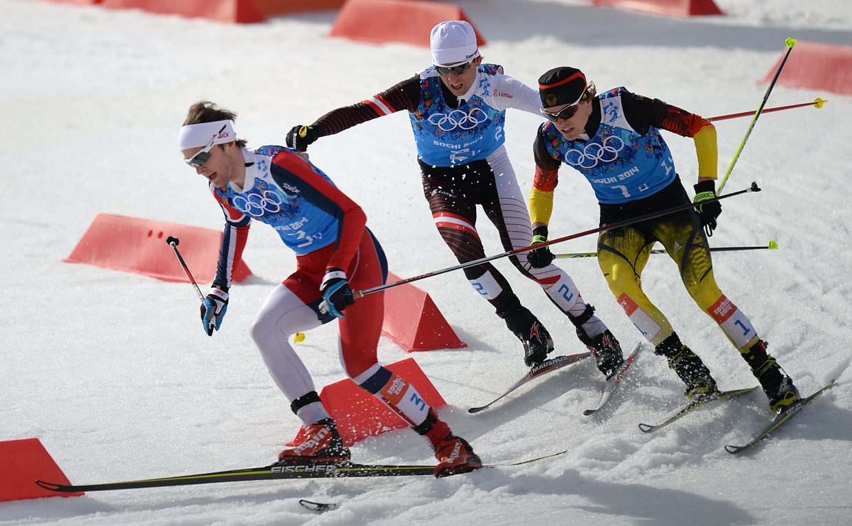 Norway's Joergen Graabak is in front as the lead pack cuts around one of the final corners before the finish line Thursday at the Nordic combined team relay event at the 2014 Winter Olympics. Graabak held on to win.
