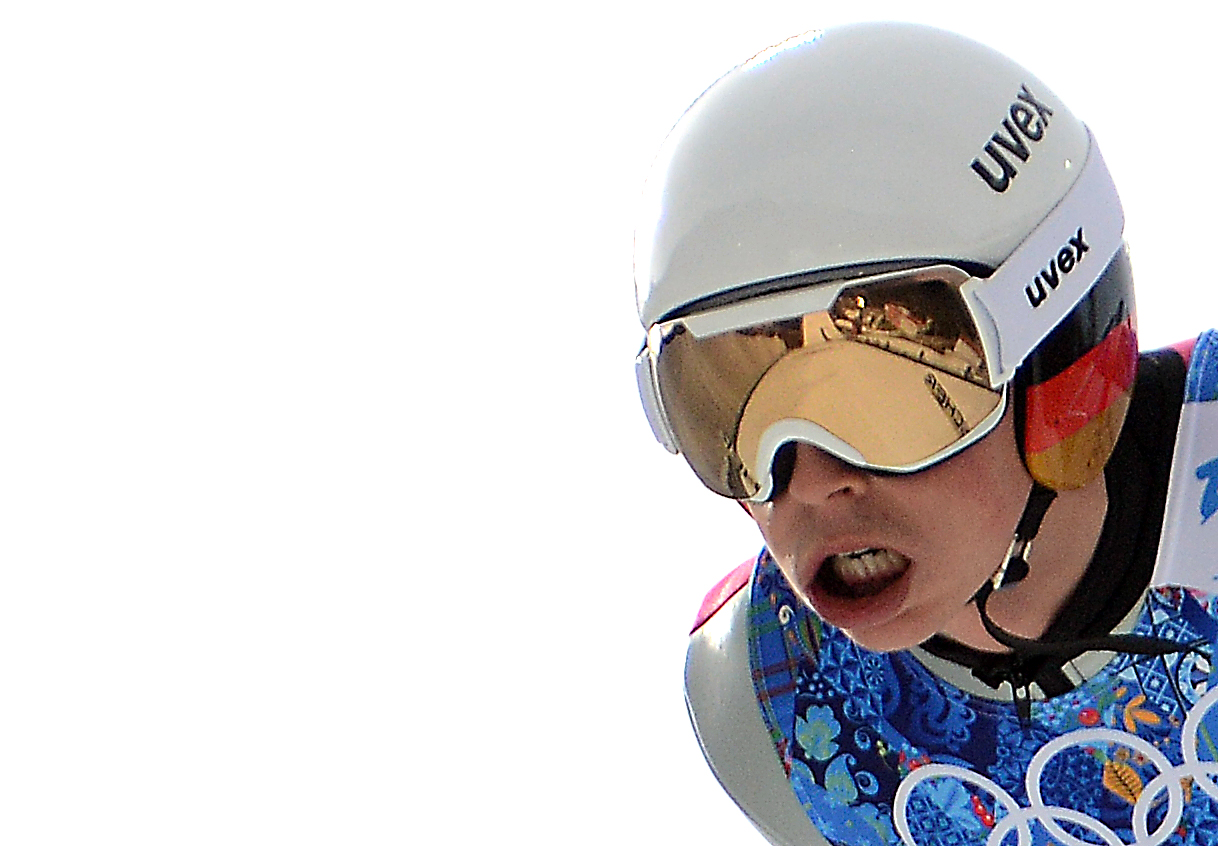 RusSki Gorki Ski Jumping Center reflects in Nordic combined normal hill gold medalist's Eric Frenzel's goggles Thursday as he jumps in the team relay event at the 2014 Winter Olympics.