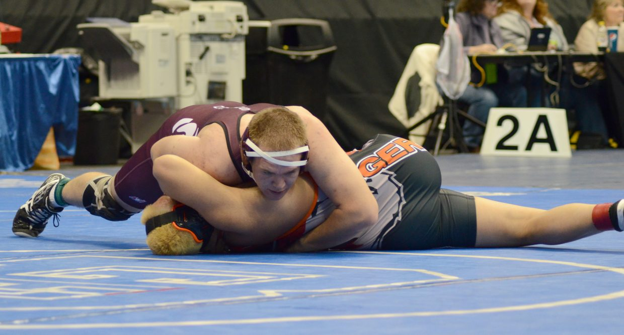 Cody Constine pushes for a pin Thursday during the 2A state wrestling tournament at the Pepsi Center in Denver. Constine got a third-round pin to move into the quarterfinals at 195 pounds, and teammate Nate Ragan also advanced in the 220-pound bracket.