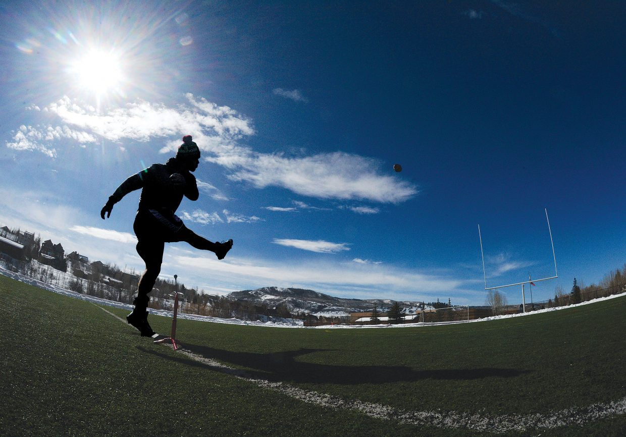 Thomas Watkins, who is taking a year off after graduating from high school in West Virginia, practices kicking field goals at Gardner Field Thursday afternoon. The high school athletic field was recently cleared of snow, and according to Greg LaPointe, it should be open through the spring for high school and club practices depending on the weather.