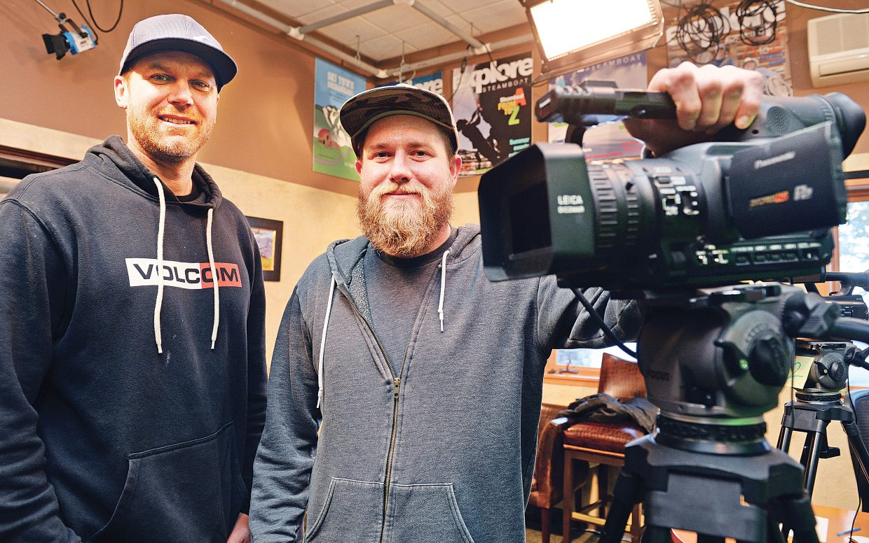 """Chad Griepentrog and David Bukowski pose for a photograph in the Steamboat TV 18 television studio Friday morning. The pair stopped by the studio to talk about working behind the scenes of """"The Bachelor,"""" as well as many other reality television shows."""