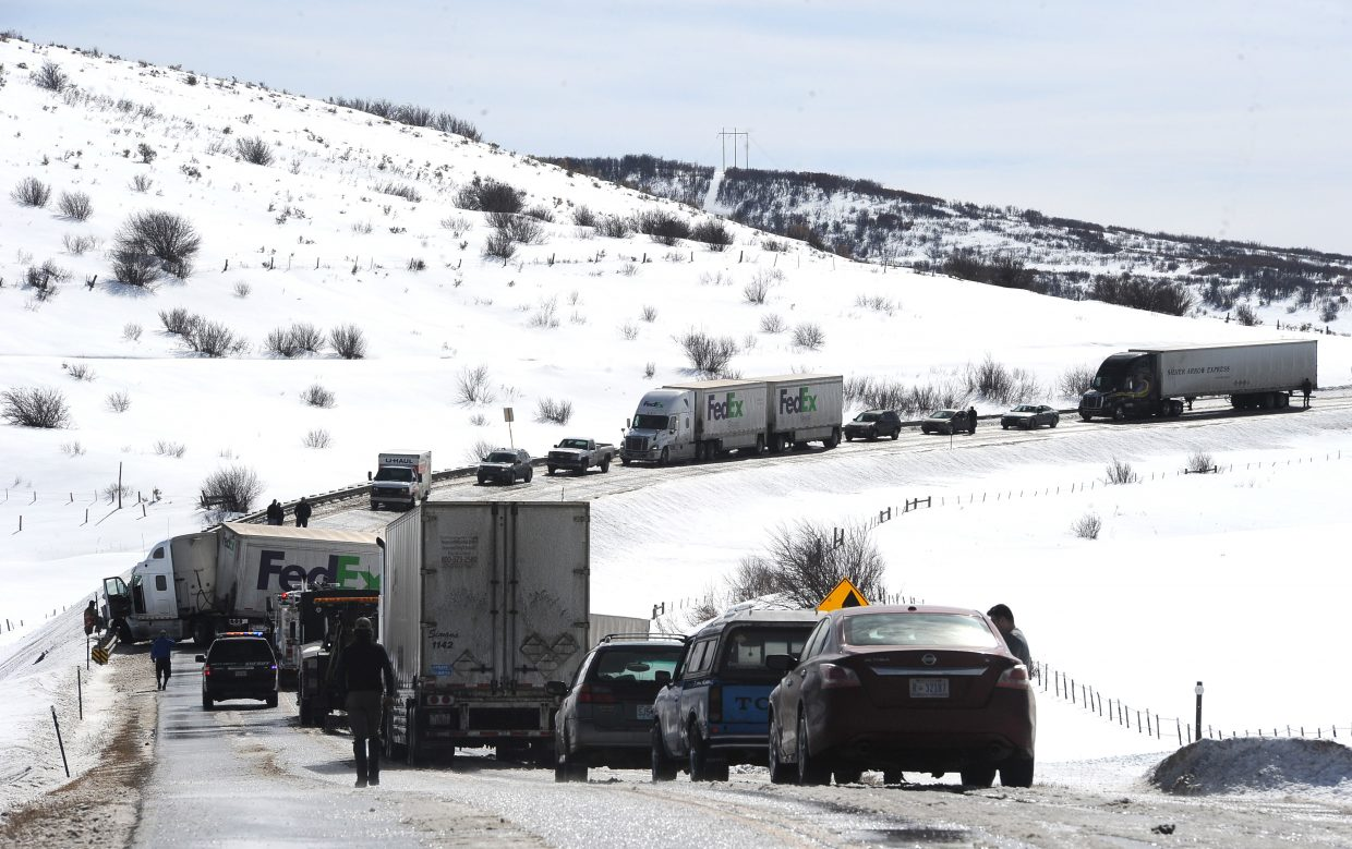 A long line of traffic waits for crews to clear a semi-truck accident that closed Colorado Highway 131 near Oak Creek for about an hour on Friday. The road, which is serving as a detour route for thousands of vehicles that cannot go through Glenwood Canyon on Interstate 70, saw traffic delays throughout the day.
