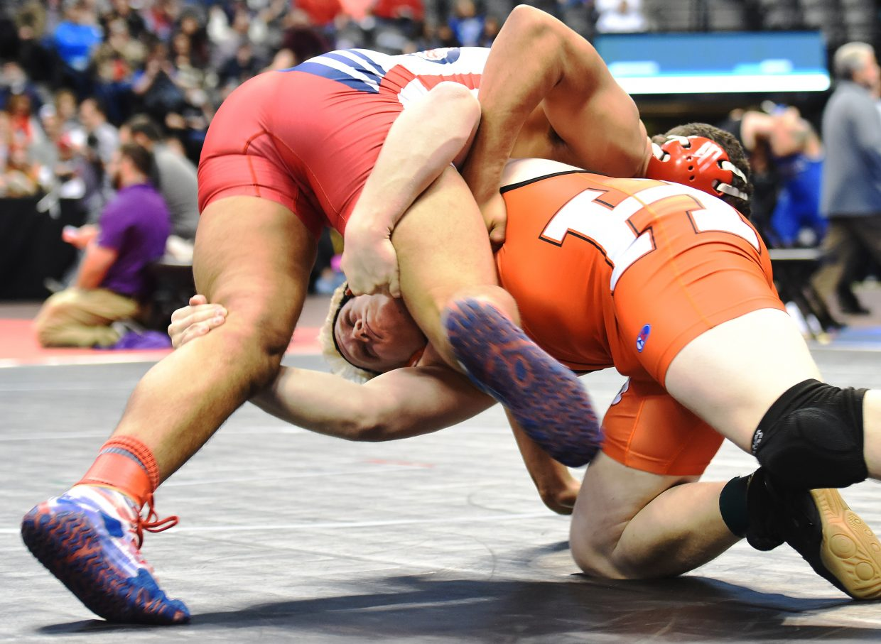 Hayden junior Christian Carson reaches for his quarterfinals opponent, Eryk Bauer of Crowley County, on Friday at the state wrestling tournament in Denver. Carson won the match, but came up just short in the state semifinal.