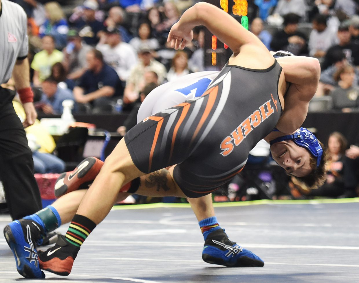 Moffat County's Mikinzie Kilmper throws La Junta wrestler Joe Martinez to the mat Friday during the Class 3A state wrestling tournament in Denver. The day didn't go as the Bulldogs had hoped, but Kilmper was one of three Moffat wrestlers to bounce back from a loss in the tournament to advance to Saturday.