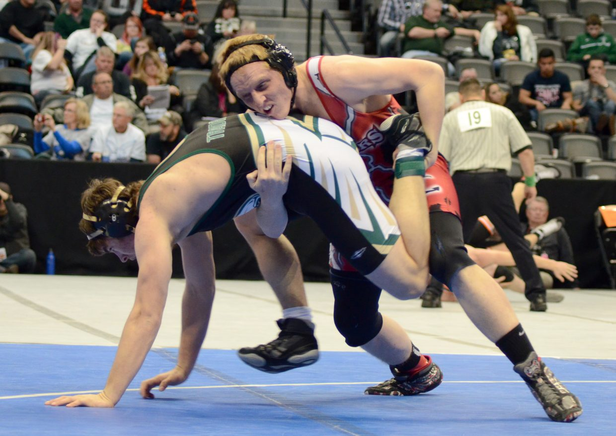 Steamboat's Brandon Yeager tries to secure a takedown during his quarterfinal match with Charlie Wallace, of Falcon. Yeager won but was beaten in the semifinals by the top seed, Mead's Kyle Couch. Yeager will start in the consolation semifinals Saturday.